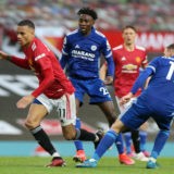 MANCHESTER, ENGLAND - MAY 11: Mason Greenwood of Manchester United in action with Marc Albrighton of Leicester City during the Premier League match between Manchester United and Leicester City at Old Trafford on May 11, 2021 in Manchester, England. Sporting stadiums around the UK remain under strict restrictions due to the Coronavirus Pandemic as Government social distancing laws prohibit fans inside venues resulting in games being played behind closed doors. (Photo by Matthew Peters/Manchester United via Getty Images)