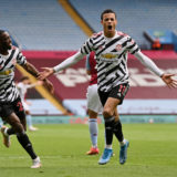 BIRMINGHAM, ENGLAND - MAY 09: Mason Greenwood of Manchester United celebrates with Aaron Wan-Bissaka after scoring their team's second goal during the Premier League match between Aston Villa and Manchester United at Villa Park on May 09, 2021 in Birmingham, England. Sporting stadiums around the UK remain under strict restrictions due to the Coronavirus Pandemic as Government social distancing laws prohibit fans inside venues resulting in games being played behind closed doors. (Photo by Shaun Botterill/Getty Images)