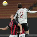 MILAN, ITALY - MARCH 18:  Victor Lindelof of Manchester United jumps for the ball against Zlatan Ibrahimovic of AC Milan during the UEFA Europa League Round of 16 Second Leg match between AC Milan and Manchester United at San Siro on March 18, 2021 in Milan, Italy. Sporting stadiums around Europe remain under strict restrictions due to the Coronavirus Pandemic as Government social distancing laws prohibit fans inside venues resulting in games being played behind closed doors. (Photo by Emilio Andreoli/Getty Images)