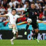 LONDON, ENGLAND - JUNE 29: Harry Maguire of England battles for possession with Kai Havertz of Germany during the UEFA Euro 2020 Championship Round of 16 match between England and Germany at Wembley Stadium on June 29, 2021 in London, England. (Photo by Carl Recine - Pool/Getty Images)