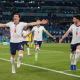 ROME, ITALY - JULY 03: Harry Maguire of England celebrates with Declan Rice after scoring their side's second goal during the UEFA Euro 2020 Championship Quarter-final match between Ukraine and England at Olimpico Stadium on July 03, 2021 in Rome, Italy. (Photo by Alessandra Tarantino - Pool/Getty Images)