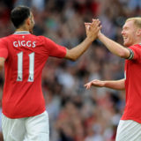 MANCHESTER, ENGLAND - AUGUST 05:  Paul Scholes of Manchester United celebrates scoring the opening goal with team mate Ryan Giggs (L) during his Testimonial Match between Manchester United and New York Cosmos at Old Trafford on August 5, 2011 in Manchester, England.  (Photo by Chris Brunskill/Getty Images)