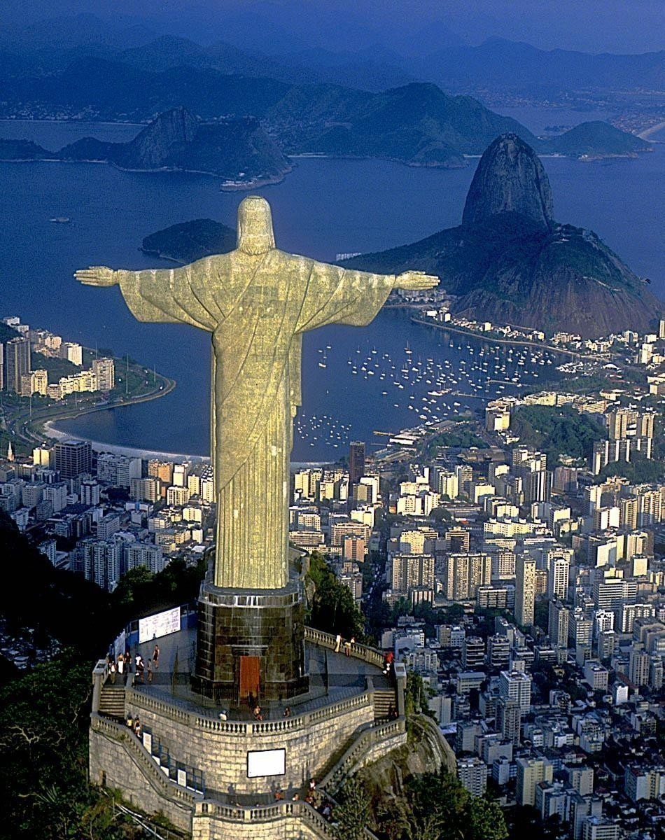 Aerial view of Christ, symbol of Rio de Janeiro, standing on top of Corcovado Hill, overlooking Guanabara Bay | Brazil Travel Guide