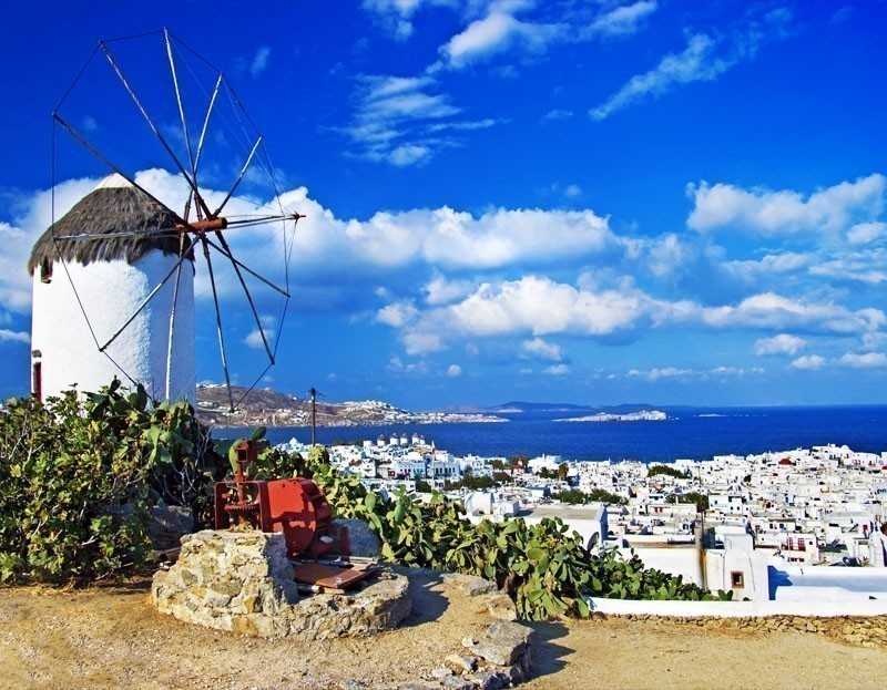 If you ever wondered where exactly the white, round shaped, 16th-century Venetian windmills with a pointed roof and very small windows are? Then the answer is—Mykonos