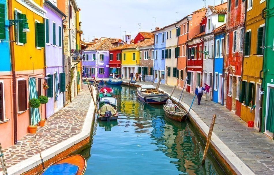Burano canal full of boats and colorful houses. | 10 of the Most Colorful Cities in the World