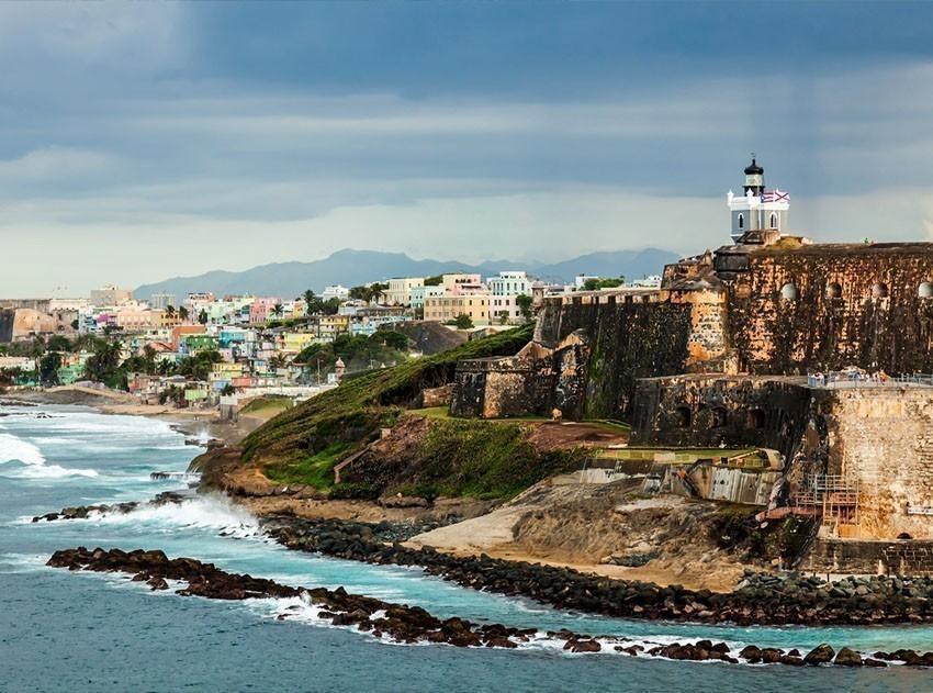 Crashing surf on the beach at El Morro Fortress San Juan | Puerto Rico Travel Guide