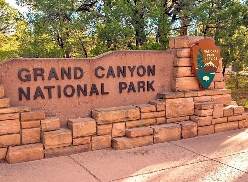 The entrance sign to Grand Canyon National Park, Arizona, USA | 7 National Parks with the Most Scenic Drives