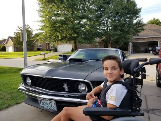 Nino Welcome and his restored Mustang Mach 1.