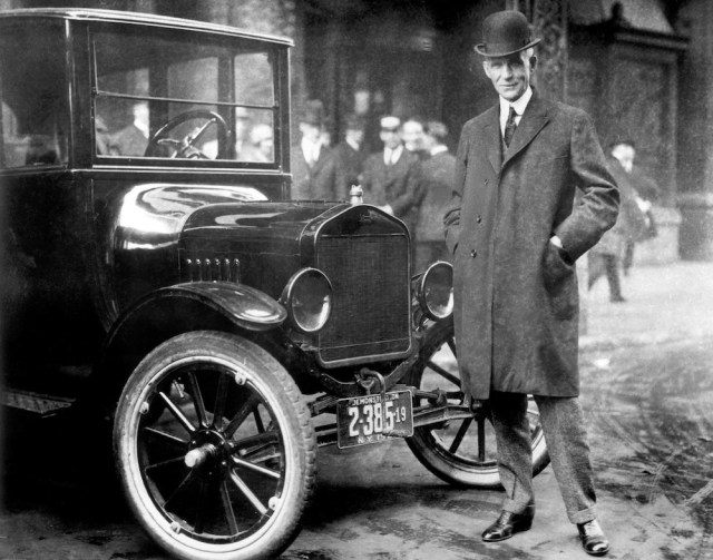 Henry Ford with a Model T, 1921.
