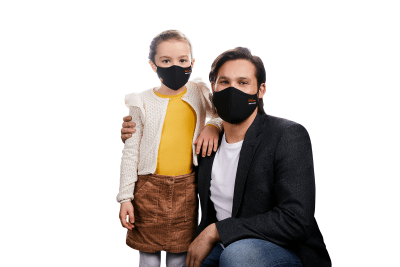 Photograph of a man and child each wearing a HeiQ Viroblock +Multi Hi-Tech Protective Washable and Reusable Black Face Mask. HeiQ Face Mask has the words HeiQ Viroblock + Multi Hi-Tech written on one side of the mask, and a tag which says Swiss Tech Inside on the other side of the mask.