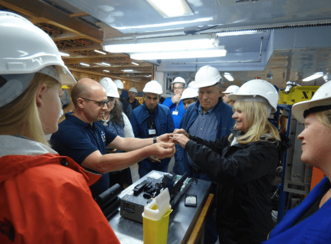 Gov. Bill Walker and First Lady Donna Walker inspect the cable that is being laid under the sea from Asia to Europe, across the top of Alaska.