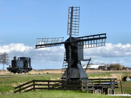 Locomotive WD33 passing a windmill in Holland.