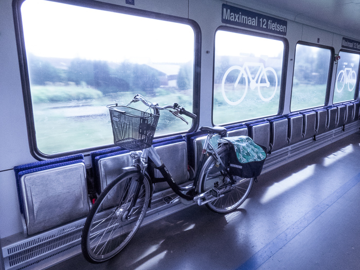 Cycling in Holland on the dykes along the river Linge. First with the bike in the train