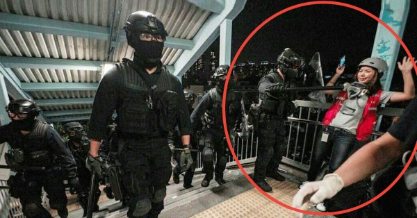 HK Policeman Threatens CNA Reporter With Baton, Leaves Her Alone After Hearing Her Case