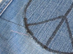 DIY knee patch being sewn on
