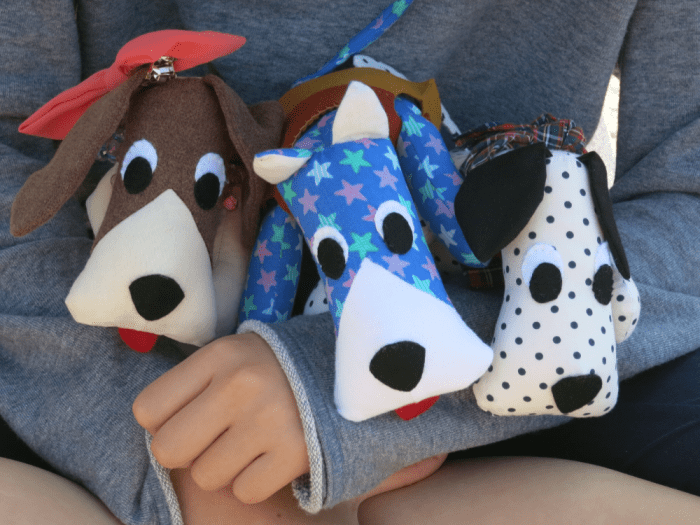 Huggable Doggy - 3 dogs in arms of a child