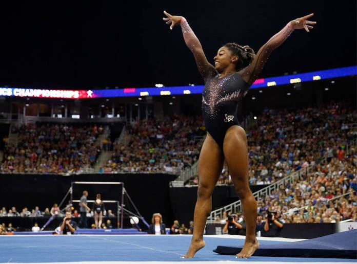 Simone Biles: The four-time Olympic gold medalist - image  on https://muvison.com