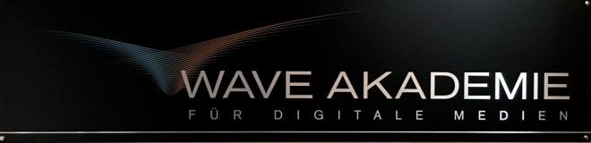 Man sieht das Logo der Wave Akademie.