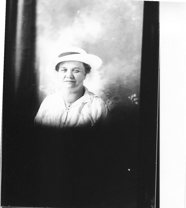 photo of Portrait of Unidentified Woman in a White Dress