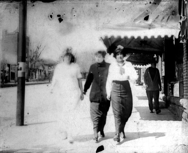 photo of Women Walking Down Main Street