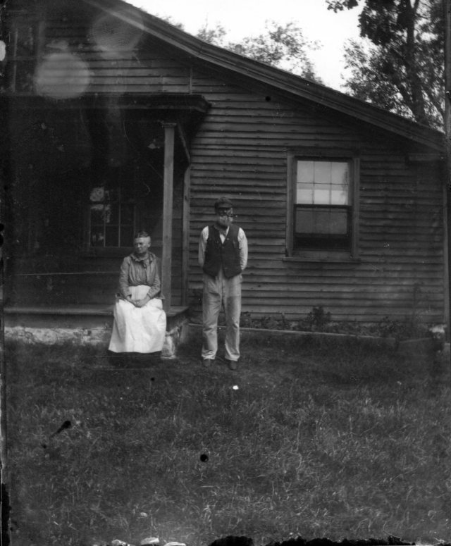 photo of Couple Outside of House