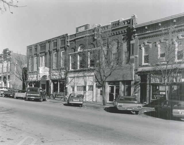 Photo of north side of First Street W. Photographed 1990