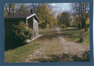 Old railroad house in a park in mid-fall