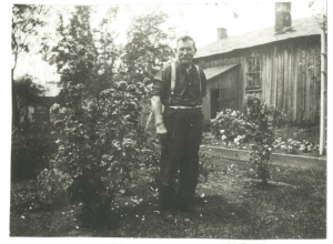 Photo of Martin Shantz in front of his blacksmith shop