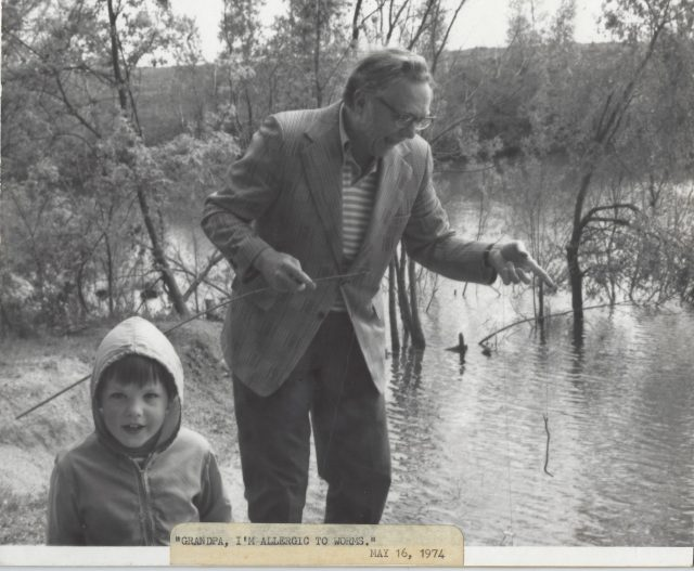 Photo of Warren Sutherland fishing with Grandpa Herman Rolufs. 1974