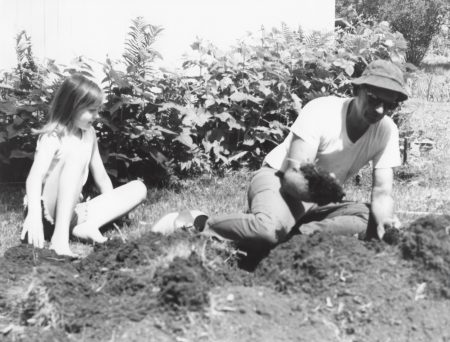 Photo of Kirsten Sutherland learns to garden from her grandfather, Robert W. Sutherland. 1974