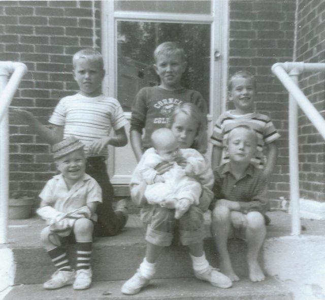 Photo of Wolfe children sitting on front steps, 1962