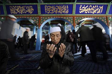 Muslim praying in an Uighur mosque in Xinjiang