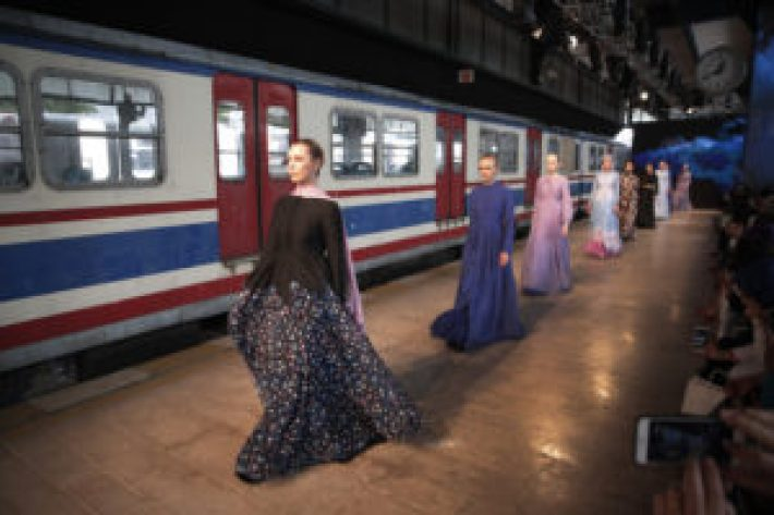 Models, featuring creations by Muslima Wear hit the catwalk of a fashion show during the International Modest Fashion Week, in Istanbul, Friday, May 13, 2016. Turkey's first International Modest Fashion Week has opened in Istanbul bringing designers and models of conservative wear from around the world. The two-day event kicked off Friday with models hitting the runway at a historic train station donning a bright palette of breezy garment and kaleidoscopic headscarves. (AP Photo/Lefteris Pitarakis)