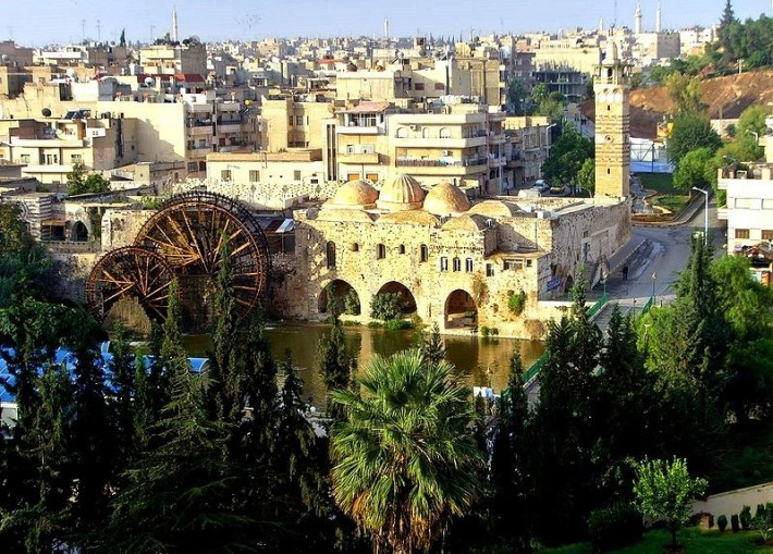 Hama city and the surviving water wheels (Arabic: Noria) used to feed into the gardens