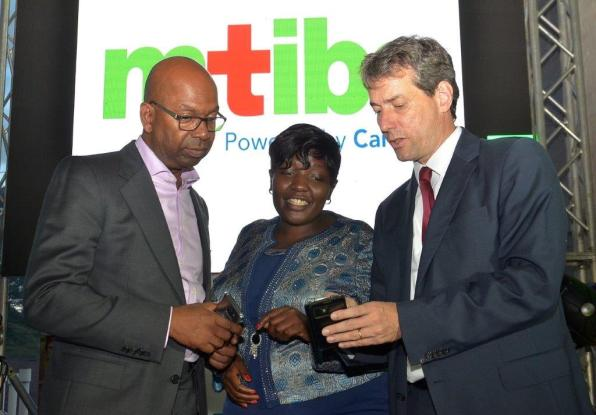 Bob Collymore (Safaricom CEO), Millicent Olulo (Country Director, Pharm Kenya)