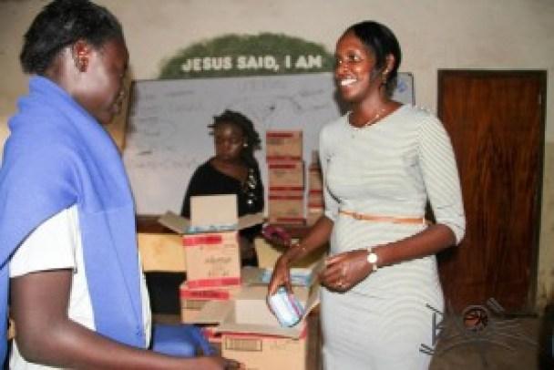 Always Brand Ambassdor Kenya Basketball captain Silalei Owour donating sanitary pads at Raila Education Center (Kibera)