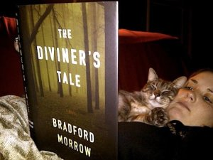 Reading The Diviner's Tale by Bradford Morrow (with my cat). My review of the book is here: ht
