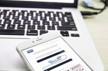 MW marketing Website iPhone and Macbook Close Up