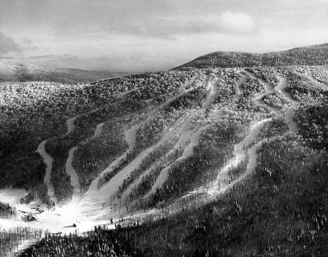 """The Balsams Wilderness Ski Area during its first year of operation. There were only eight trails at this time. Neither Connecticut """"0"""" or Notch """"11"""" had been built yet. The ridge of Dixville Peak can be seen in the background along the right side. Photo Credit: Dick Smith - 1967"""
