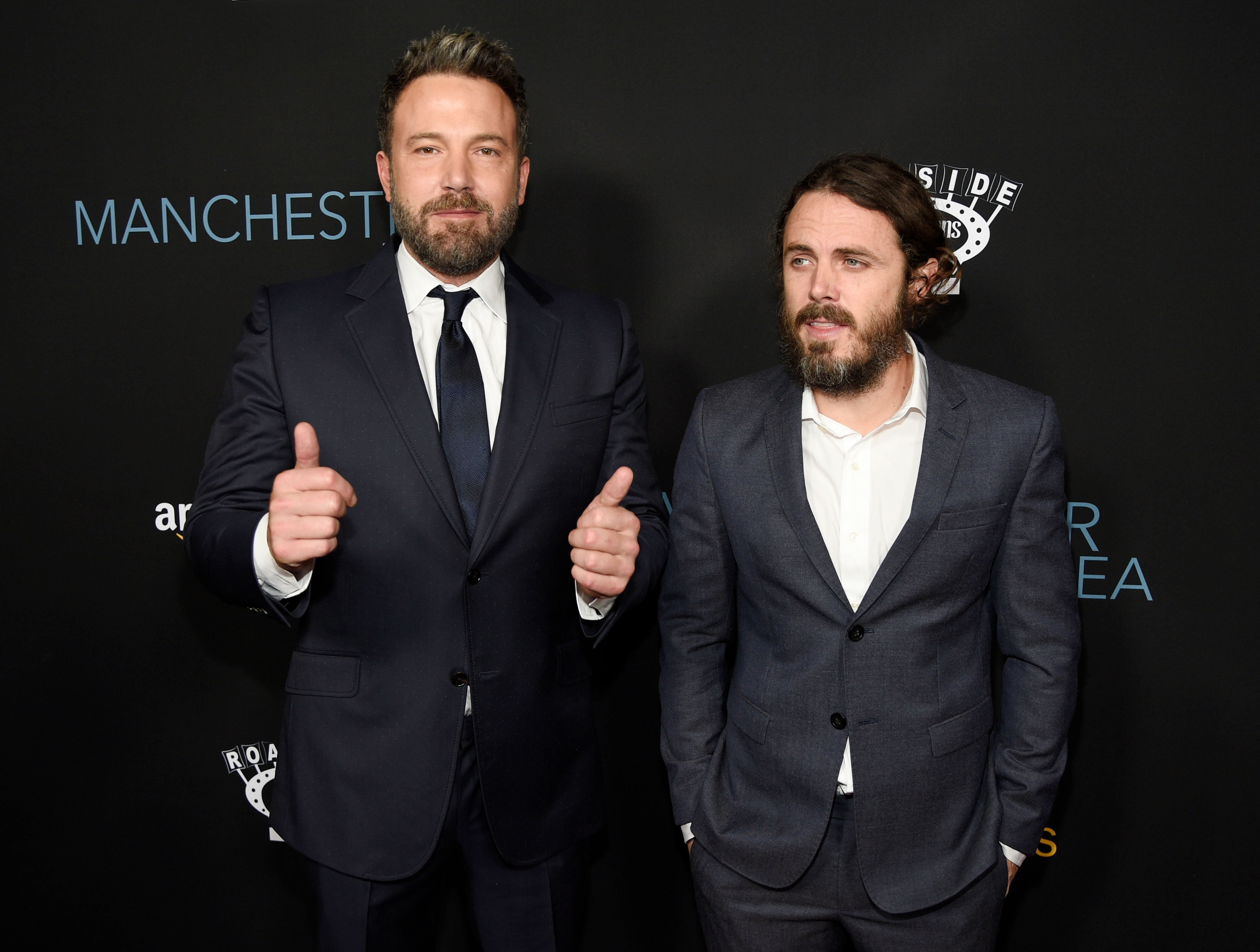 """Casey Affleck, right, a cast member in """"Manchester by the Sea,"""" poses with his brother Ben Affleck at the premiere of the film at the Samuel Goldwyn Theater on Monday, Nov. 14, 2016, in Beverly Hills, Calif. (Photo by Chris Pizzello/Invision/AP)"""