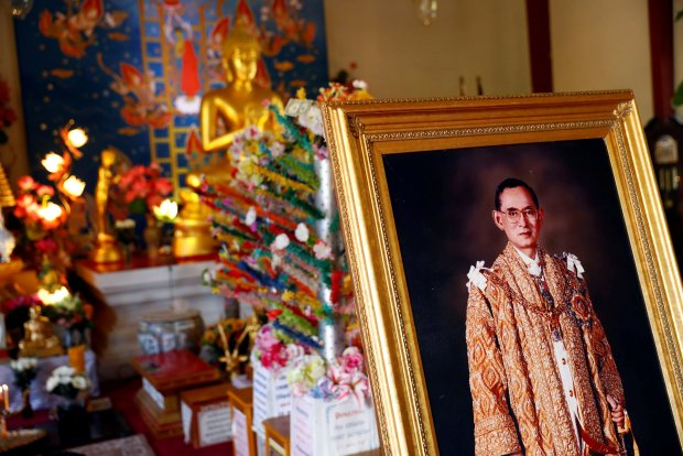 A portrait of Thailand's King Bhumibol Adulyadej stands as people memorialize his death at the Wat Thai of Los Angeles temple in Los Angeles, California