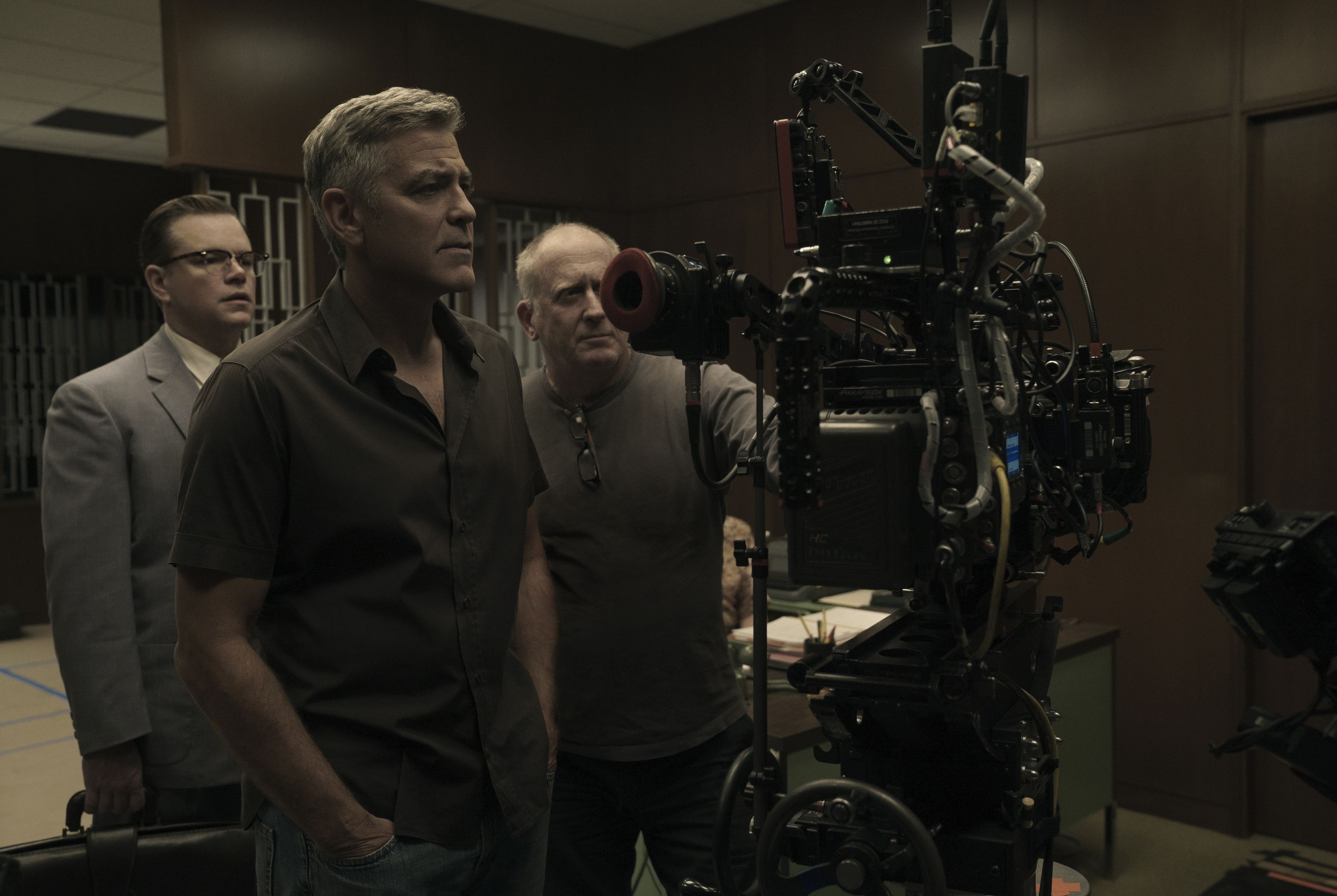 Left to right: Matt Damon, Director George Clooney and Cinematographer Robert Elswit on the set of SUBURBICON, from Paramount Pictures and Black Bear Pictures.