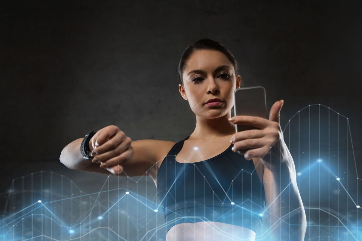 Sport Fitness Technology And People Concept Young Woman With Heart Rate Watch And Smartphone In Gym Woman With Heart Rate Watch And Smartphone In
