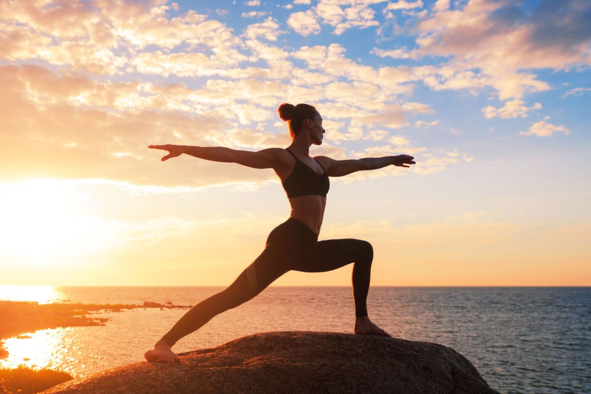 Caucasian Fitness Woman Practicing Yoga Caucasian Fitness Woman Practicing Yoga At Sunset