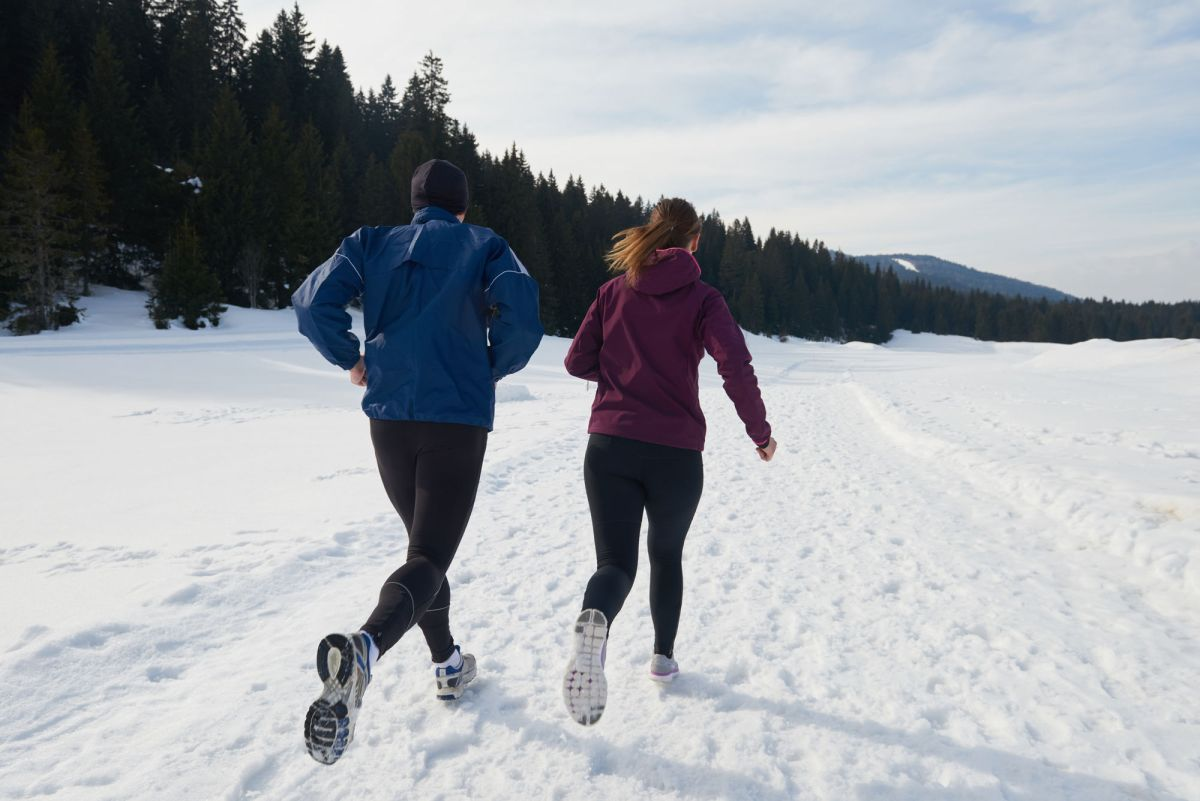 Healthy Young Couple Jogging Outside On Snow In Forest Athlete Running On Beautiful Sunny Winter Day