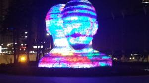 Big colorful heads in digital media city