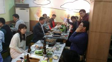 Korean BBQ to celebrate promotions. Very big social event and people rotate seats and eat BBQ for a couple of hours. And Soju