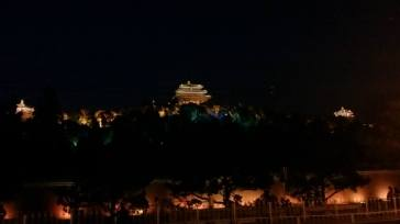 Looking up at Jingshan Park at night