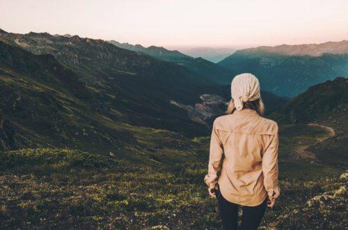 A woman walking through mountains enjoying nature