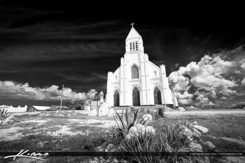 The church from Curacao in black and white with dark sky and hite clouds. Image processed using Lightroom.